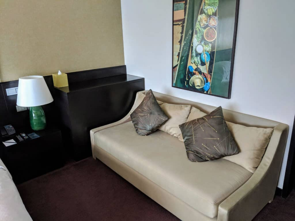 Millennium Hilton Bangkok - worn-out sofa for extra guests