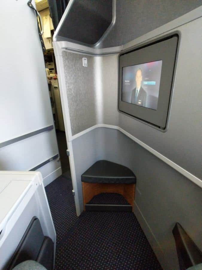 American Airlines 777-200 Business Class, front view of the seat. Note the galley nearby